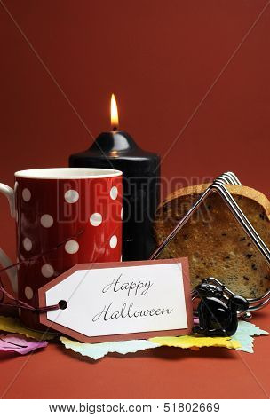 Happy Halloween Morning Breakfast With Red Polka Dot Coffee Tea Cup Mug And Toast With Black Candle