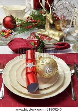 Modern And Stylish Christmas Dinner Table Setting Including Plates, Glasses And Placemats, Bon Bons