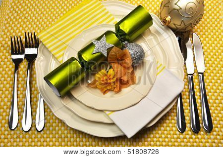 Yellow Christmas Holiday Table Setting With Plates, Cutlery, Baubles, Christmas Cracker Bon Bons