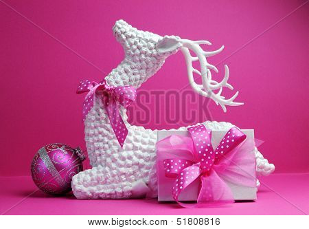 White Reindeer, Pink Bauble And Present Gift Festive Holiday Christmas Still Life Against A Feminine