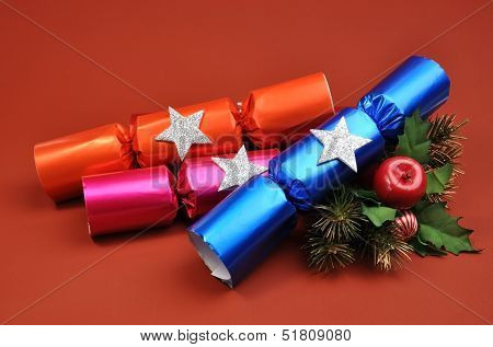 A Group Of Bright And Colorful - Pink, Blue And Orange - Christmas Cracker Bon Bons Grouped Together