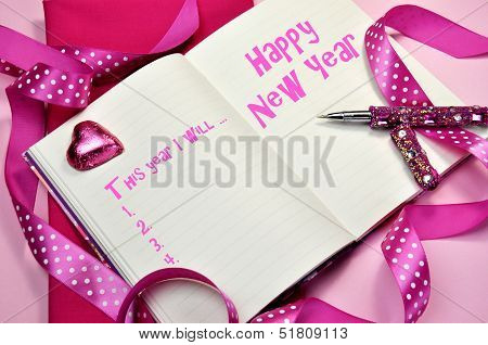 Happy New Year Resolutions In Diary Jounrnal Book With Pretty Feminine Pink Ribbons, Heart Chocolate