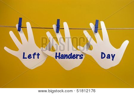 Left Handers Day Message Greeting Across Left Hand Silhouette Cards Hanging From Pegs On A Line