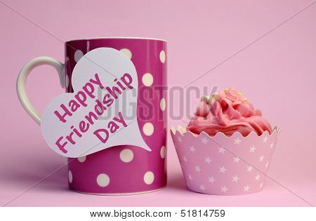 Happy Friendship Day Message Text Written On White Heart Tag Sign On Pink Polka Dot Cup