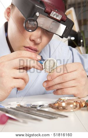 Watchmaker. Watch repair craftsman repairing watch