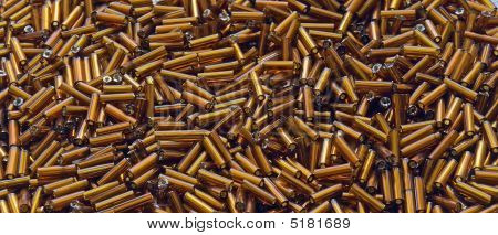 Heap Of Brown Cylindrical Beads