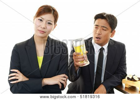 Frowning woman with drunken man