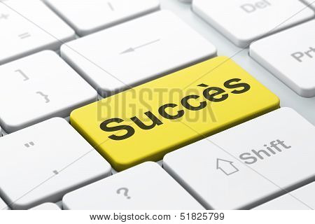 Finance concept: Succes(french) on computer keyboard background