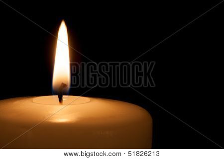 White Candle On Black Background
