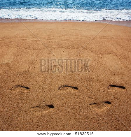 Human Foot Prints In The Sand