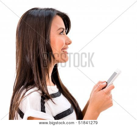 Woman texting on her cell phone - isolated over a white background