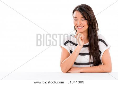 Woman looking at something on the desk - isolated over white background