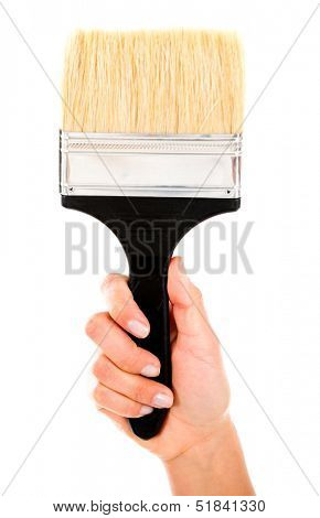 Hand holding a clean paint brush - isolated over white background