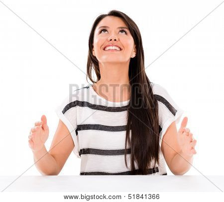 Woman holding imaginary object - isolated over a white background