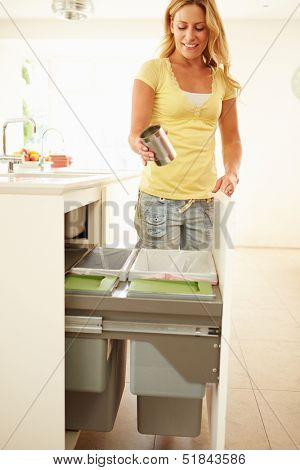 Woman Recycling Kitchen Waste In Bin