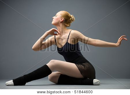 Dancing on the floor ballerina, isolated on grey. Concept of elegant art and sportive hobby