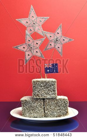 Australia Day, January 26, Laminton Cakes With Stars And An Australian Flag Against A Red And Blue B
