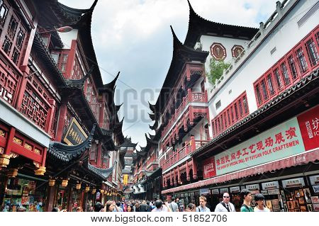 SHANGHAI, CHINA - MAY 30: Chenghuangmiao street with travelers and pagoda style buildings on May 30, 2012 in Shanghai. It is the largest city by population in the world with 23 million in 2010
