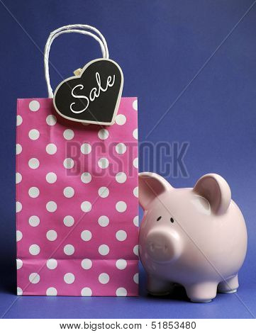 Retail Shopping Sale Promotion With Pink Polka Dot Bag And Piggy Bank With Sale Message On Heart Sha