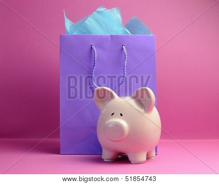 Retail Therapy, Savings, Concept With Colorful Shopping Bags Against A Pink Background, With Piggy B