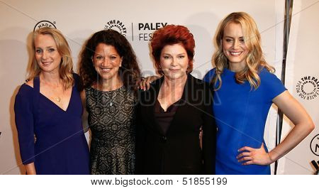 NEW YORK-OCT 2: (L-R) Piper Kerman, Debra Birnbaum, Kate Mulgrew and Taylor Schilling attend 'Orange Is the New Black' at 2013 PaleyFest at Paley Center for Media on October 2, 2013 in New York City.
