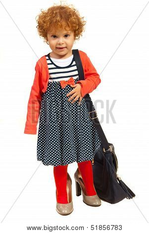 Girl In Big Shoes Carry Mom's Bag
