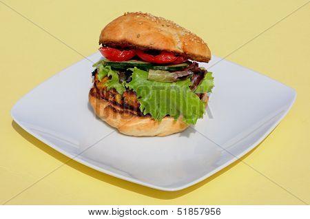 Veggie burger on sesame seed bun.