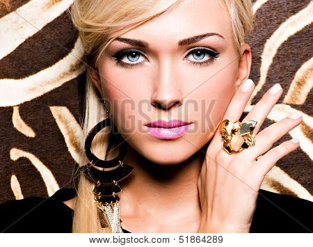 Beautiful Face Of Young Woman With Fashion Makeup