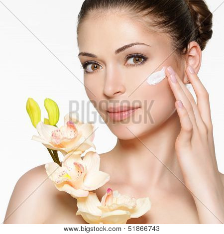 Beauty Face Of Woman With Cosmetic Cream On Face