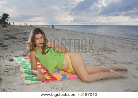 Pretty Girl With Yellow Bikini Laying On A Towel