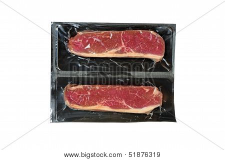 strip loin steak in plastic wrap