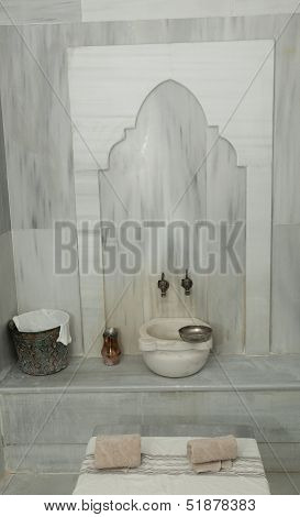 an empty classic turkish hamam bath with towel