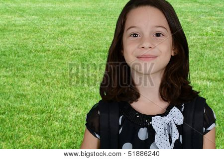Portrait of a girl who is standing outside