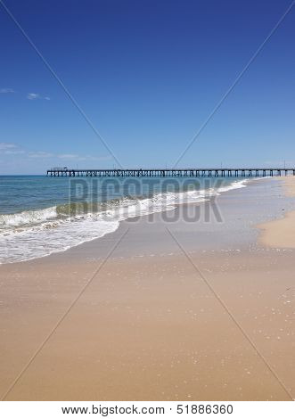 Open Beach With Jetty In Background