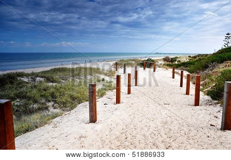 Path Leading Down To Henley Beach, South Australia, Showing White Sandy Beach, Jetty In Background,