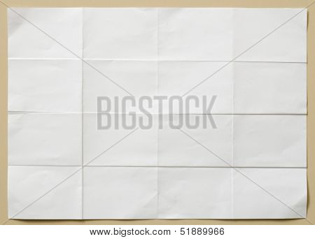White Textured Sheet Of Paper Folded In Sixteen  Part