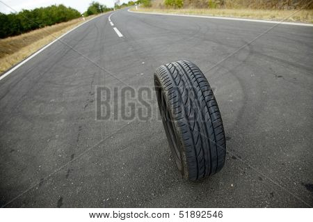 Wheel of a car on the asphalt