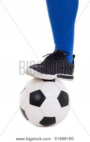 Leg Of Soccer Player In Blue Gaiter With Ball Isolated On White