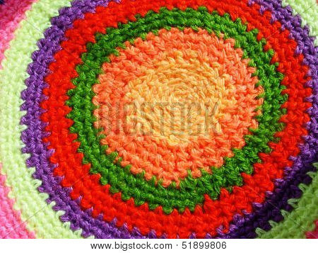 Multi-colored knitted rug