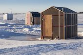 image of shacks  - Rustic ice fishing shacks out on the ice - JPG