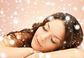 health and beauty concept - beautiful woman with long eyelashes in spa