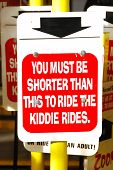 stock photo of kiddie  - Sign to ride rides or Adult at an amusement park - JPG