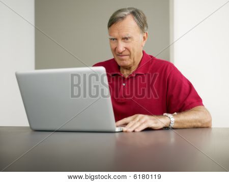 Senior Using Laptop Computer
