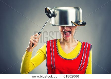Crazy housewife with sause pan