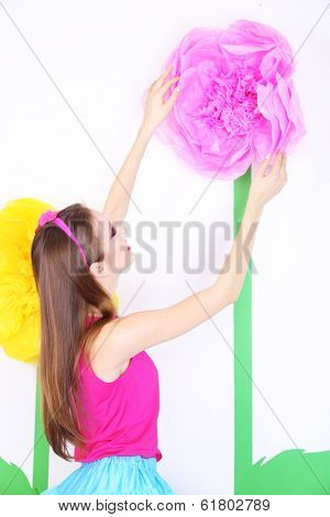 Beautiful young woman in petty skirt with big flower close up