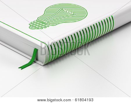 Finance concept: closed book, Light Bulb on white background