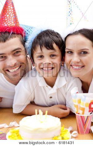 Smiling Family Celebrating Sons Birthday