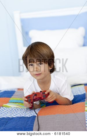 Boy In His Bed Playing Videogames