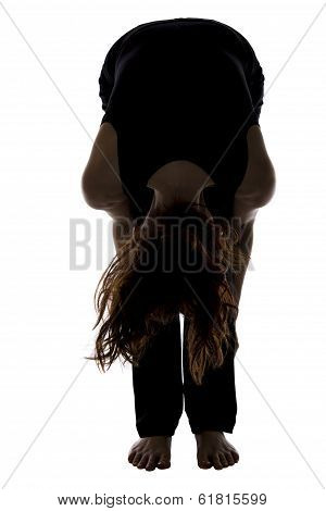 Woman In Standing Forward Bend Pose In Yoga, Silhouette