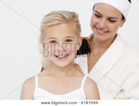 Beautiful Mother Doing Daughter's Hair